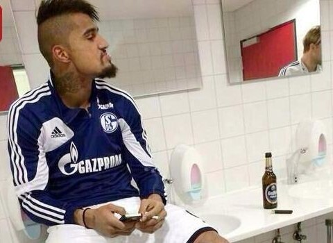 Kevin-Prince Boateng pictured drinking beer and smoking cigarette immediately after match
