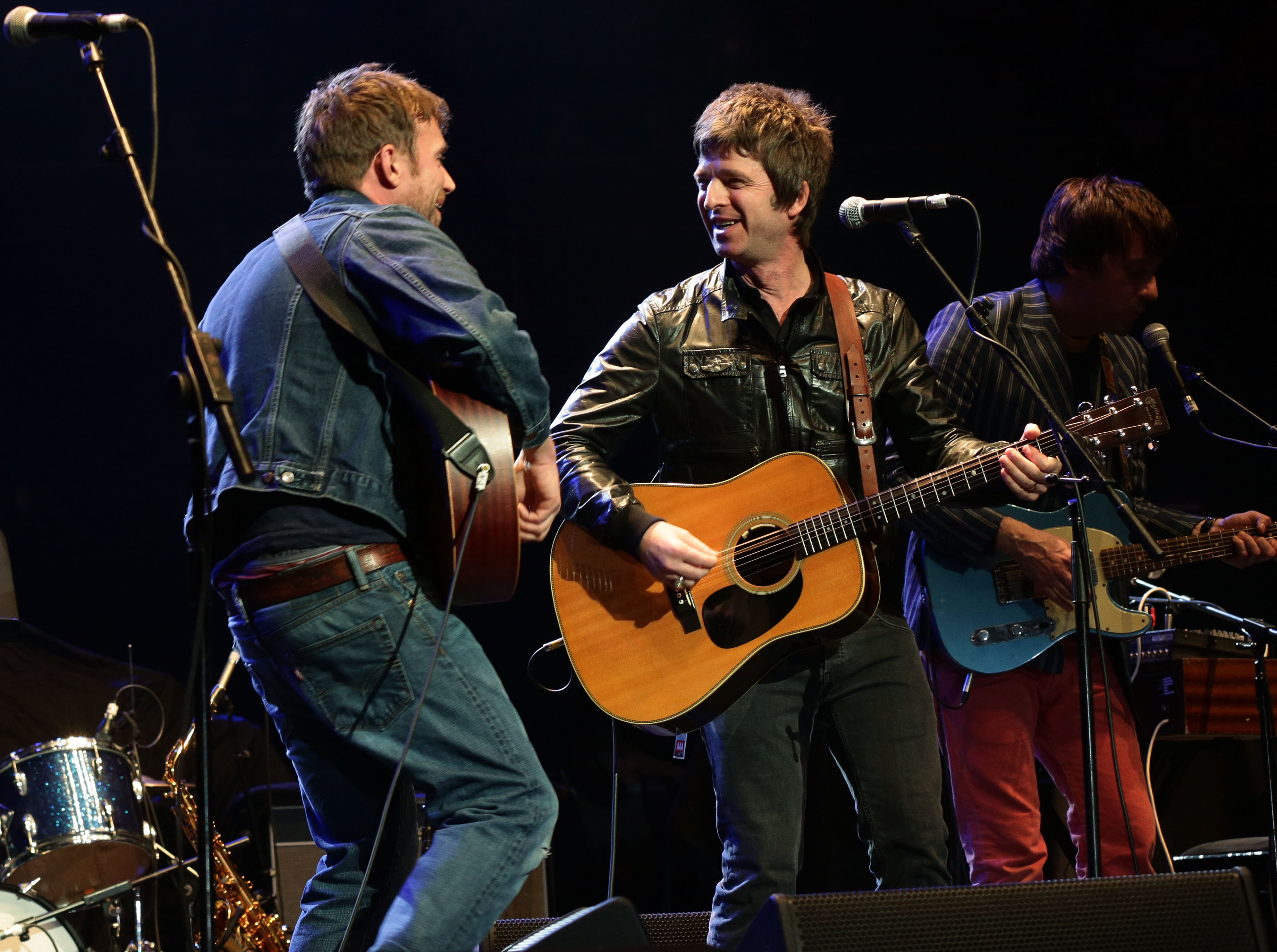 Former chart rivals Damon Albarn and Noel Gallagher on stage together at the Royal Albert Hall during last year's Teenage Cancer Trust gigs (Picture: PA)