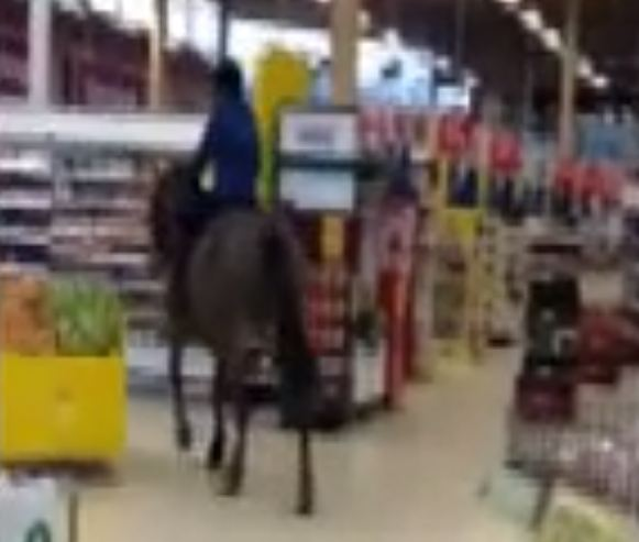 Woman rides horse inside Tesco and downs drink in Neknomination challenge