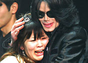 Michael Jackson hugs one of his fans