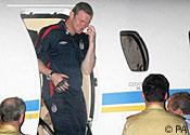 Wayne Rooney arriving back