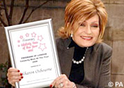 Sharon grins with her award
