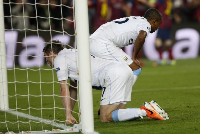 Manchester City's James Milner, left and Fernandinho Luiz Roza react after Barcelona scored their second goal during a Champions League, round of 16, second leg, soccer match between FC Barcelona and Manchester City at the Camp Nou Stadium in Barcelona, Spain, Wednesday March 12, 2014. (AP Photo/Emilio Morenatti) AP Photo/Emilio Morenatti