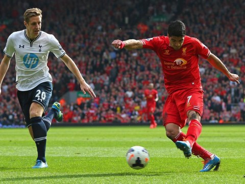Younes Kaboul own goal and sensational Luis Suarez put Liverpool in control of title race