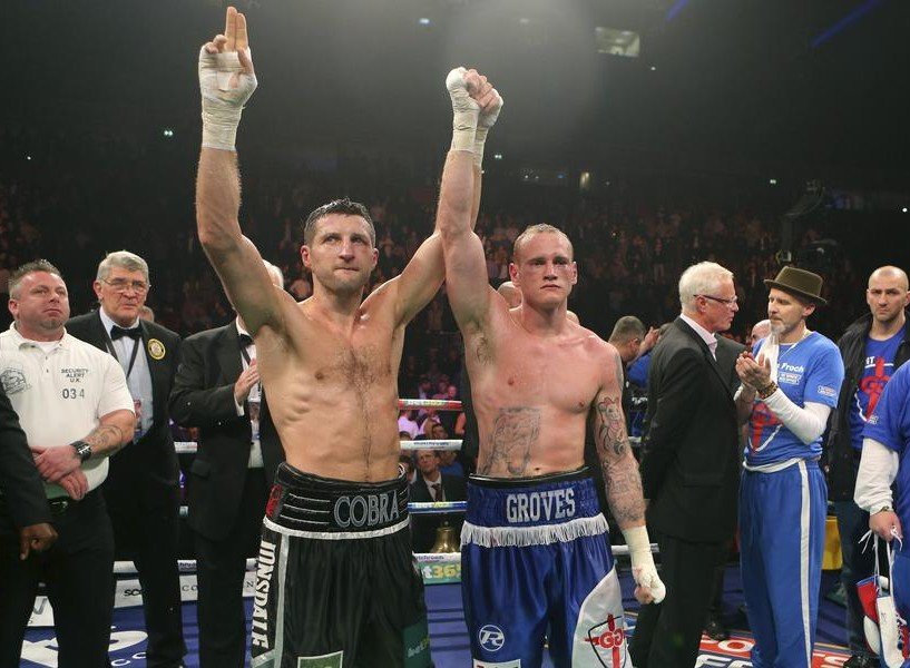 Carl Froch, left, celebrates victory over George Groves (Picture: AP)
