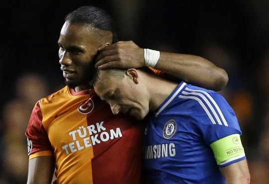 Galatasaray's Didier Drogba, left, embraces Chelsea's John Terry at the end of the Champions League round of 16 second leg soccer match between Chelsea and Galatasaray at Stamford Bridge stadium in London Tuesday, March 18, 2014. (AP Photo/Kirsty Wigglesworth) AP Photo/Kirsty Wigglesworth