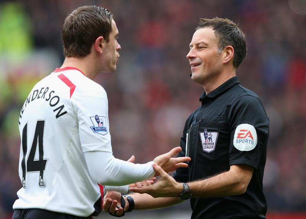 Referee Mark Clattenburg speaks to Liverpool's Jordan Henderson (Picture: Getty Images)