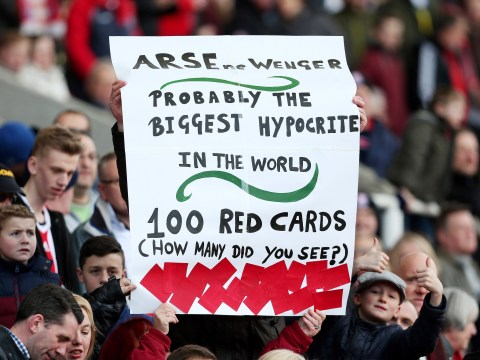 Stoke City fans mock 'hypocrite' Arsene Wenger with banner during Arsenal match