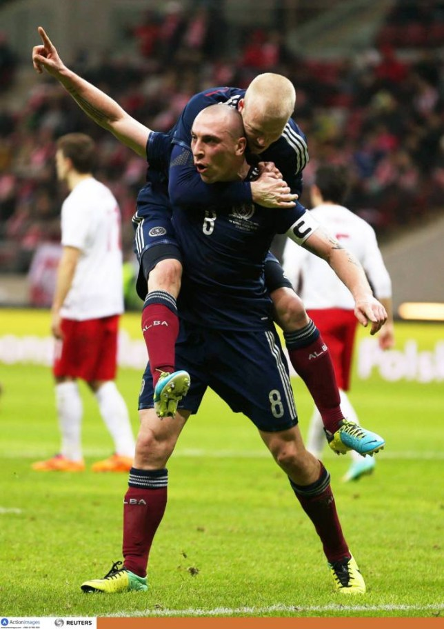Football - Poland v Scotland - International Friendly  - National Stadium, Warsaw, Poland - 5/3/14  Scott Brown (L) celebrates with team mates after scoring the first goal for Scotland  Mandatory Credit: Action Images / Peter Cziborra  Livepic  EDITORIAL USE ONLY.