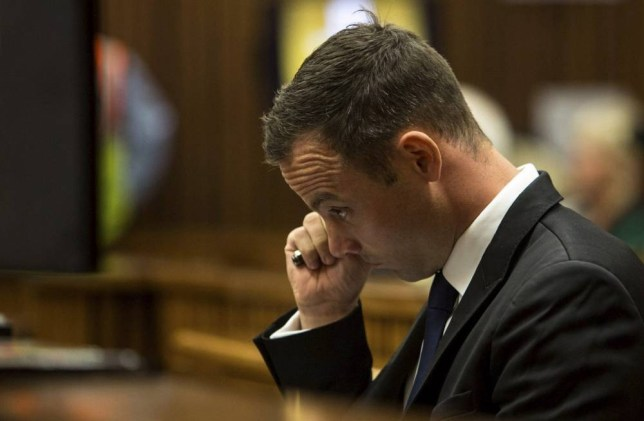 Gun lover: Oscar Pistorius stares into the distance as his listens to more evidence in court (Picture: Getty)