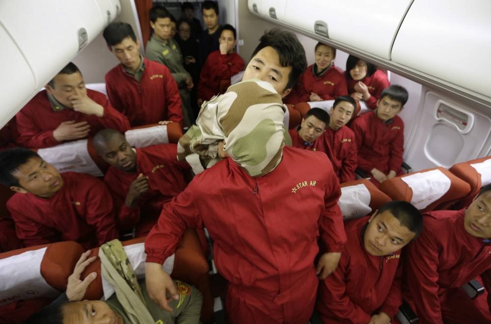 Pictures: Chinese bodyguards taught importance of aviation safety procedures in wake of MH370 missing flight