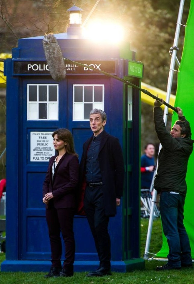 Mandatory Credit: Photo by Polly Thomas/REX (3658565y)  Jenna Coleman and Peter Capaldi  'Doctor Who' TV series filming, Hadyn Ellis Building, Cardiff University, Wales, Britain - 18 Mar 2014