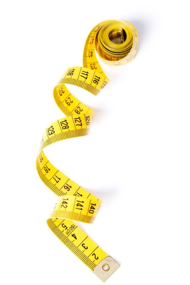 Yelow measuring tape, isolated on white; Shutterstock ID 126134450; Dept: Metro Features; Name: Jenny Reilly; Job: diet and detox; Page/Date: 24/03/2014