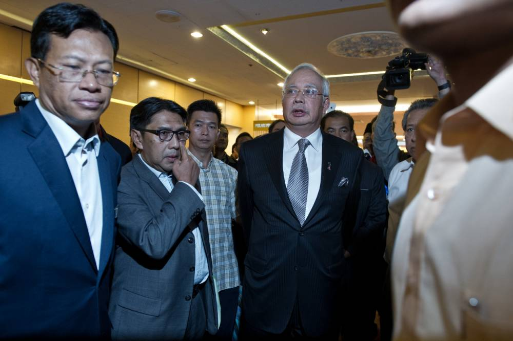 Malaysian prime minister: Missing flight MH370 'ended in Indian Ocean and no one on board survived'