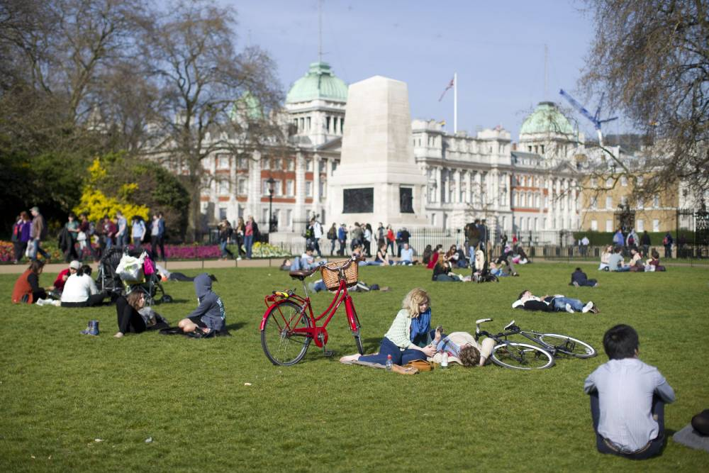 People enjoy sunny weather in Green Park in London, as Britain is due to be warmer than mainland Spain and Ibiza next week as temperatures here reach 21C (70F), forecasters said. PRESS ASSOCIATION Photo. Picture date: Saturday March 29, 2014. See PA story WEATHER Warm. Photo credit should read: Justin Tallis/PA Wire