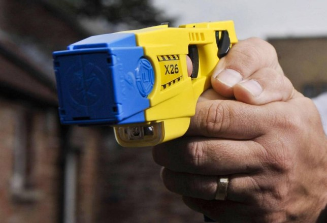 A police officer holding a Taser during a training exercise