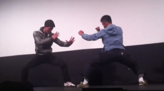 Iko Uwais and Cecep Arif Rahman know how to entertain a crowd of The Raid fans (Picture: OneofUsNet/YouTube)