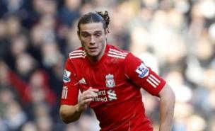 Andy Caroll has made just seven appearances for Liverpool since he moved in January, but could face Spurs (PA)
