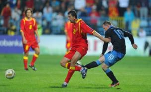Wayne Rooney saw red in Montenegro for this kick (Getty Images)