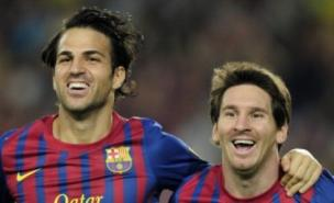 Fabregas (left) is suited to the Barca shirt, says Walcott