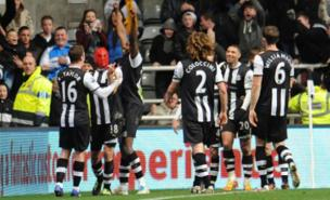 Newcastle's players celebrate Jonas 'Spider-Man' Gutierrez's winner (PA)