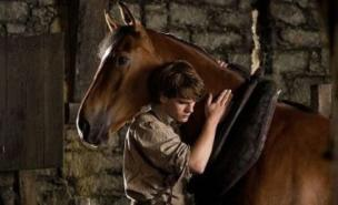 War Horse beat off competition from new films to retain its box office top spot