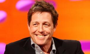 Hugh Grant is besotted with his Ferrari (PA)