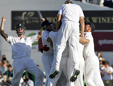 Cook, left, celebrates with the winning ball in his pocket