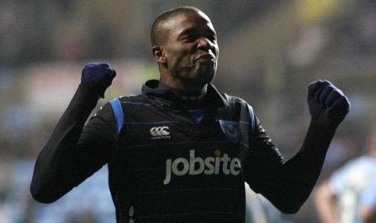 Portsmouth's Aaron Mokoena celebrates scoring the late winner