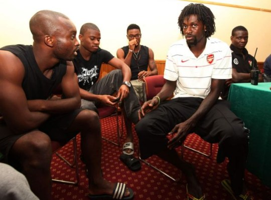 Emmanuel Adebayor, in Arsenal shirt, attends a Togo team meeting yesterday