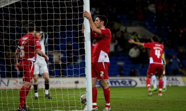 Bristol City defender Bradley Orr (C) looks on dejectedly after scoring an own goal
