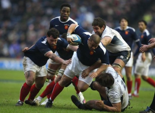 Luc Ducalcon of France is tackled