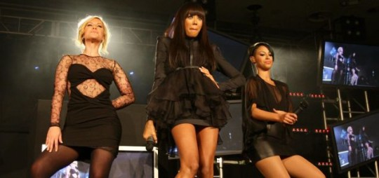 Amelle on stage (right) with Sugababes Heidi (left) and Jade (middle)