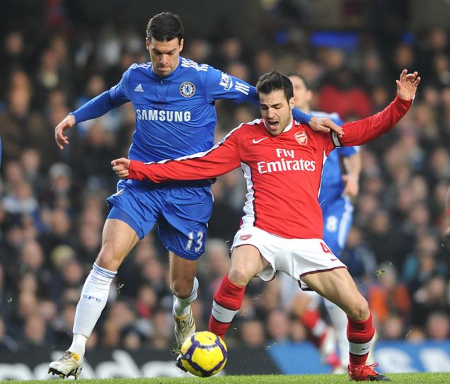 Chelsea's Michael Ballack (left) and Arsenal's Cesc Fabregas (right) battle for the ball