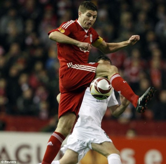 Flying high: All-action captain Steven Gerrard helped Liverpool to victory at Anfield