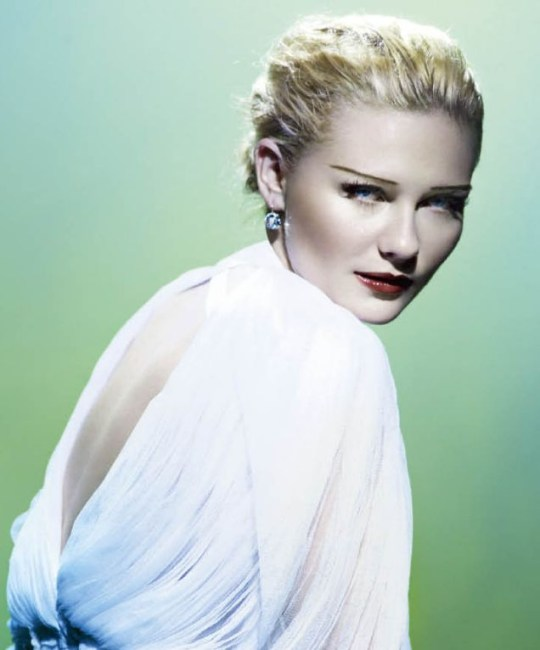 Kirsten Dunst poses for celeb photographer Mario Testino