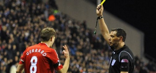 Steven Gerrard's V-sign at Andre Marriner