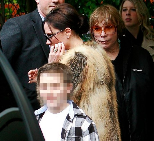 Shirley MacLaine gives Victoria Beckham a serious look as she awaits for her car and Victoria walks right by her at a party in Beverly Hills
