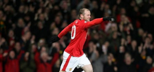 Wayne Rooney celebrates as Manchester United cruise into the Champions League quarter-finals
