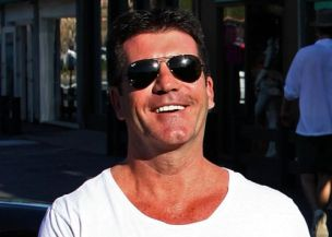 Simon Cowell may spend £1 million on his wedding reception
