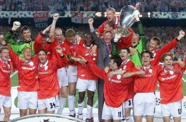 Manchester United manager Alex Ferguson celebrates with his players, after they defeated Bayern Munich 2-1 in the Champions League final in Barcelona in 1999
