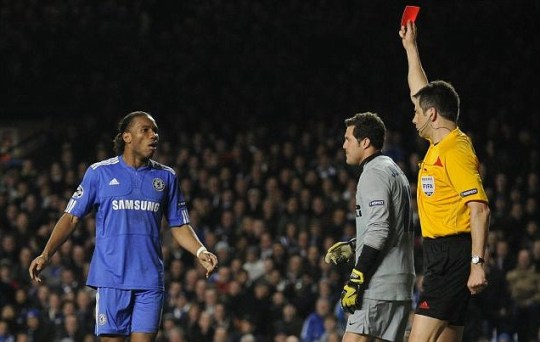 Drogba in the doghouse: Chelsea striker Didier is red carded against Inter Milan