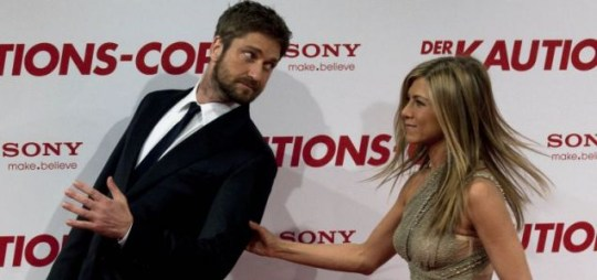 Jennifer Aniston tries to grab a hold of Gerrard Butler