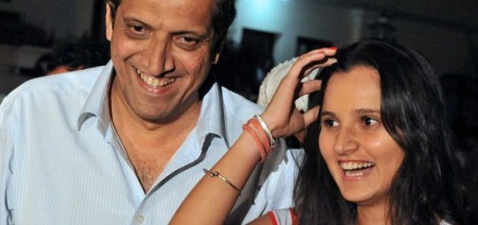 Indian tennis player Sania Mirza smiles at a press conference with her father, announcing her marriage to Shoaib Malik