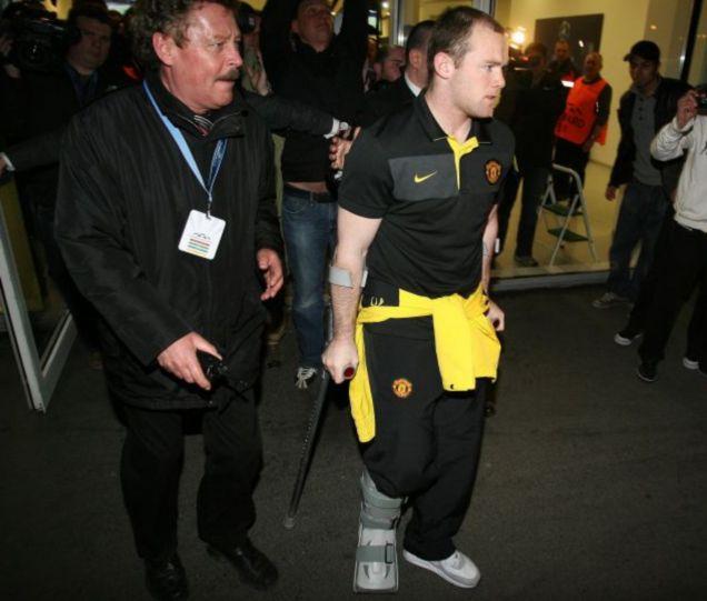 Wayne Rooney crutches
