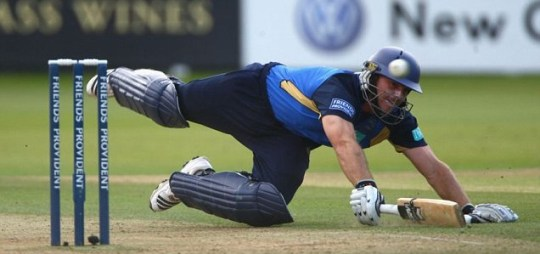 Michael Lumb scrambles to make his ground while playing for Hampshire last year