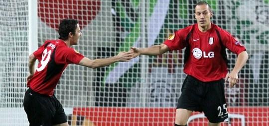 Bobby Zamora (R) celebrates scoring with Welsh teammate Simon Davies