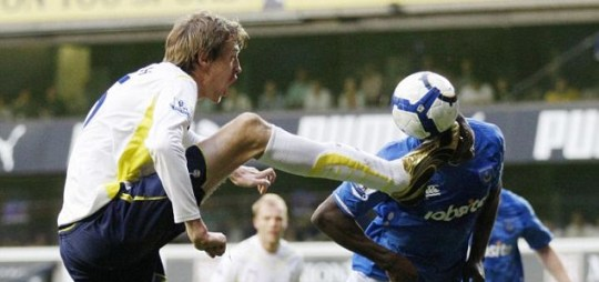 Spurs' Peter Crouch and Portsmouth's Aaron Mokoena