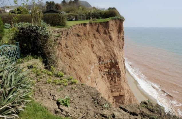 Closer to home: This jagged new cliff face now confronts Tony and Biddy Miller at the bottom of their garden (Picture: Apex)