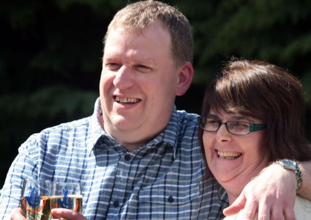 Jackpot: Mr and Mrs McIntosh celebrate their £4,460,495 Lotto win (Picture: PA)